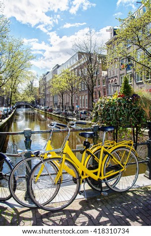Amsterdam street scene. Bicycles against a backdrop of traditional old dutch houses on the bridge in spring. Amsterdam, Netherlands