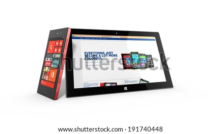 AMSTERDAM, THE NETHERLANDS, 30 APRIL 2014 - Microsoft Surface tablet with Nokia Lumia smartphone in store. - stock photo