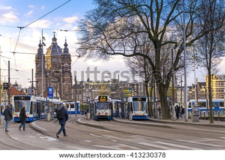 Amsterdam, The Netherlands - April 7, 2016: The tram station in front of Centraal station. Amsterdam Centraal station is the largest train station of Amsterdam and a major national rail hub.