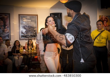 Amsterdam, The Netherlands - August 27, 2016: couple dancing salsa at the closing party at Rialto Cinema during World Cinema Amsterdam festival, a world film festival held from 18 to 27/08/2016
