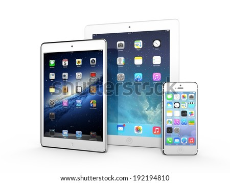 AMSTERDAM, THE NETHERLANDS, CIRCA APRIL 2014 - Three Apple iOS devices on display: iPad 3, iPad Mini and iPhone 5s. - stock photo