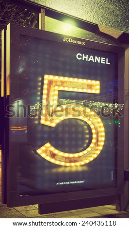 AMSTERDAM, THE NETHERLANDS - DEC 20, 2014: Chanel ad for Chanel No.5 fragrance advertising campaign at the Rembrandt square tram stop. Filtered toned image in instagram look. - stock photo