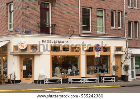 AMSTERDAM, THE NETHERLANDS - DECEMBER 23, 2016: Front of a Bagels & Beams restaurant by a street in the city center