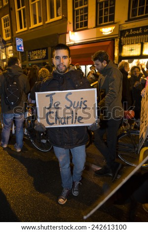 Amsterdam, The Netherlands, January 08 2015: demonstation in solidarity with the attack against Charlie Hebdo in Paris, France on 07 January - stock photo