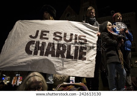 """Amsterdam, The Netherlands, January 08 2015: demonstation in solidarity with the attack against Charlie Hebdo in Paris, France on 07 January, people holding a sign saying """"I am Charlie"""" - stock photo"""