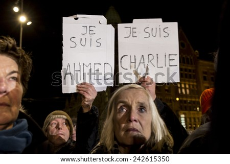"""Amsterdam, The Netherlands, January 08 2015: demonstration in solidarity with the attack against Charlie Hebdo in Paris, France on 07 January, people holding a sign saying """"I am Charlie"""" - stock photo"""