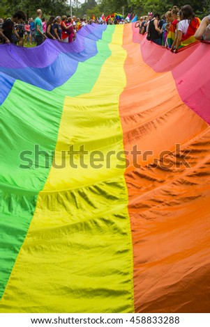 Amsterdam, the Netherlands - July 23, 2016: Raimbow flag spread and held by people during Pride Walk, demonstration parade from Vondelpark to Dam Square, Pink Saturday Gay Euro Pride celebrations