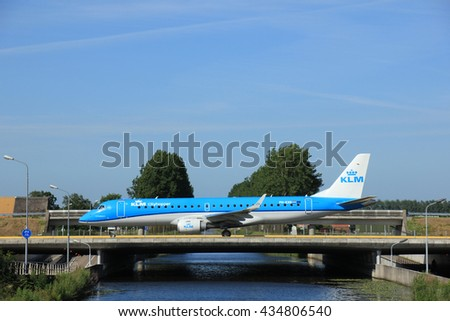 Amsterdam, the Netherlands - June 9th 2016:  PH-EXD KLM Cityhopper Embraer ERJ-190STD, taxiing to Polderbaan runway Schiphol, destination Bristol, United Kingdom