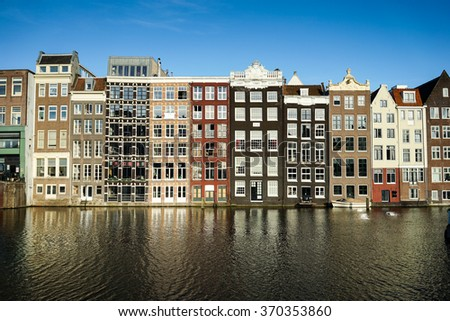 Amsterdam The Netherlands - June 15: Traditional old buildings in Amsterdam, the Netherlands on June 15, 2015. - stock photo