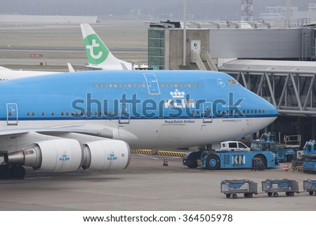 AMSTERDAM, THE NETHERLANDS - MAART 15, 2015: Boeing 747 parked at the gate on the plane platform from schiphol Airport on maart 15 , 2015 in Amsterdam (Schiphol ), Holland.  - stock photo