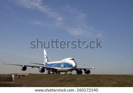 AMSTERDAM, THE NETHERLANDS - Maart 11, 2015 :.Just landed Air Bridge Cargo Boeing 747 to wipe the freight center to unload its cargo and load new On maart 11 , 2015 in Amsterdam, Holland.   - stock photo