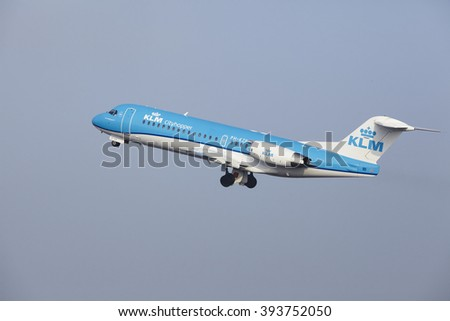 AMSTERDAM, THE NETHERLANDS - MARCH, 11. A Fokker 70 of KLM Cityhopper takes off at Amsterdam Airport Schiphol (The Netherlands, AMS) on March 11, 2016. The plane is already high in the air.
