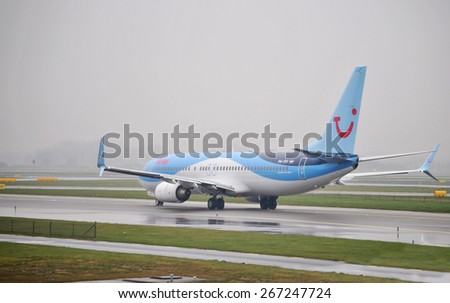 AMSTERDAM, THE NETHERLANDS, 26 MARCH 2015 - Boeing airplane from TUI in Amsterdam, Schiphol, The Netherlands. - stock photo