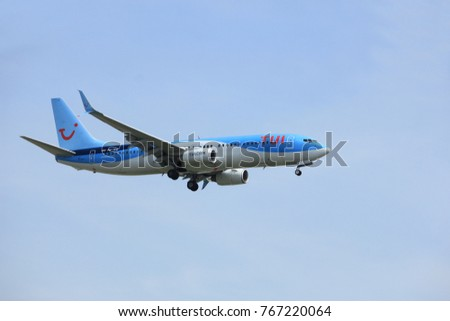 Amsterdam, the Netherlands - March 31st, 2017: PH-TFD TUI Airlines approaching Polderbaan runway at Schiphol Amsterdam Airport, the Netherlands