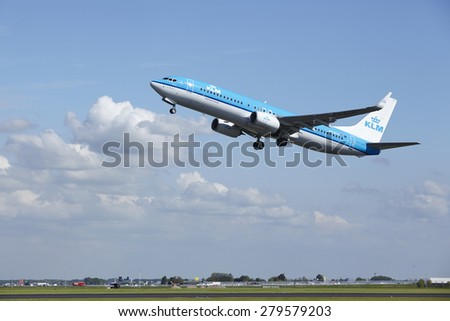 AMSTERDAM, THE NETHERLANDS - MAY, 13. A Boeing 737-8K2 of KLM takes off at Amsterdam Airport Schiphol (The Netherlands, AMS) on May 13, 2015. The name of the runway is Polderbaan.
