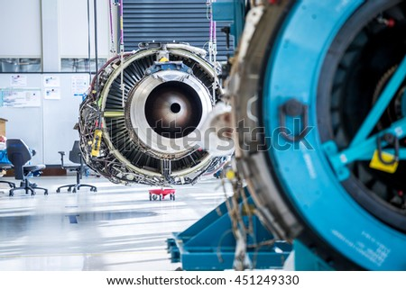 Amsterdam, The Netherlands - May 20, 2016: Engine's maintenance in huge industrial hall . - stock photo