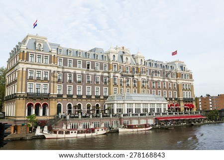 AMSTERDAM, THE NETHERLANDS - MAY 11, 2015: Famous Amstel Hotel in the center of Amsterdam, The Netherlands.