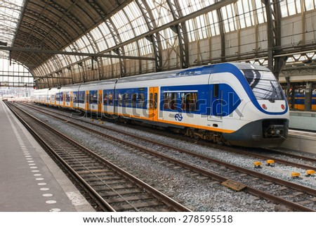 Amsterdam, The Netherlands - May 1, 2015: Intercity Train parked at Amsterdam Centraal station.