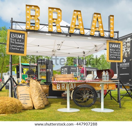 AMSTERDAM, THE NETHERLANDS - MAY 14, 2016: Mobile kitchen Braai sells  barbecued meat during the annual mobile kitchens weekend, held in the city's Culture park