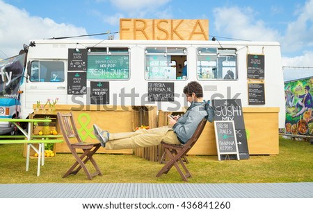 AMSTERDAM, THE NETHERLANDS - MAY 14, 2016: Mobile kitchen Friska sells biological healthy fastfood during the annual mobile kitchens weekend, held in the city's Culture park