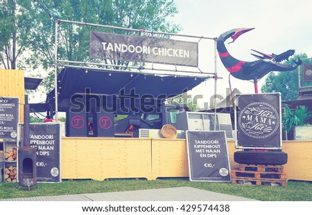 AMSTERDAM, THE NETHERLANDS - MAY 14, 2016: Mobile kitchen Hot Mama Hot sells chicken dishes during the annual mobile kitchens weekend, held in the city's Culture park. Instagram-like filter is applied
