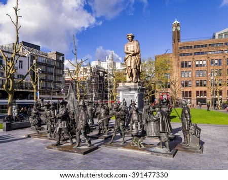 Amsterdam, the Netherlands, May 23, 2013: Statue of the painter Rembrandt on Rembrandtplein with bronze statues depicting his Night Watch painting. - stock photo