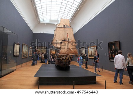 AMSTERDAM, THE NETHERLANDS - MAY 4, 2016: Visitors at the famous Rijksmuseum in Amsterdam, Netherlands. Exhibition devoted to maritime conquest of Holland.