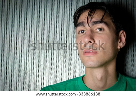 Amsterdam, the Netherlands - 26 October 2015: British singer Oscar Scheller poses backstage after his show at Paradiso Music Hall.