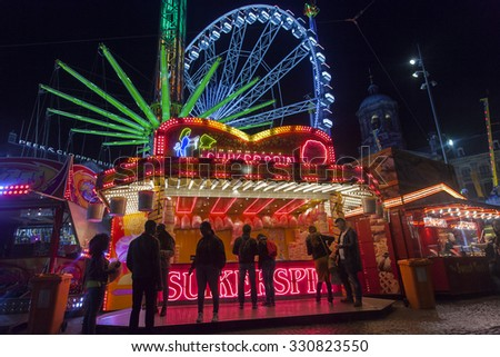 AMSTERDAM, THE NETHERLANDS - OCTOBER 20, 2015: People buying cotton candy at annual funfair on Dam square in Amsterdam.