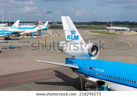 AMSTERDAM, THE NETHERLANDS - SEP 11: Schiphol airport with workers and departing and arriving airplanes on September 11, 2014 at Amsterdam, the Netherlands