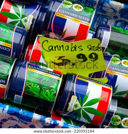 AMSTERDAM - THE NETHERLANDS, SEPTEMBER 10, 2014: Cans with cannabis seeds for sale on a market in Amsterdam on Sept. 10, 2014 in Amsterdam, Holland