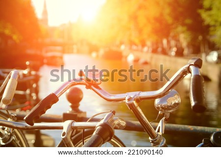 Amsterdam view with bicycles under sun light - stock photo