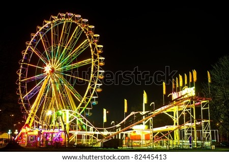 Amusement park at night - ferris wheel and rollercoaster
