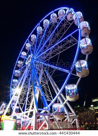 Amusement park attractions. Ferris wheel at night - stock photo