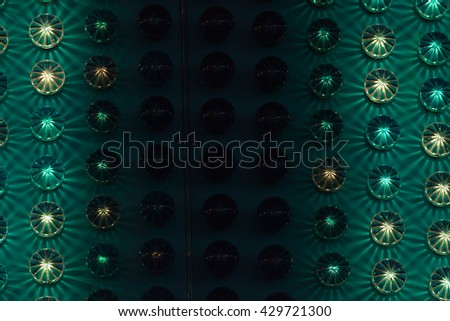 Amusement park background detail with green and yellow lights. - stock photo
