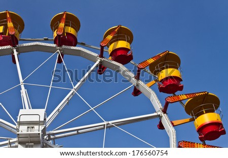 Amusement park carousel wheel on a sunny summer day - stock photo
