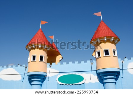 amusement park castle on the blue sky background  - stock photo