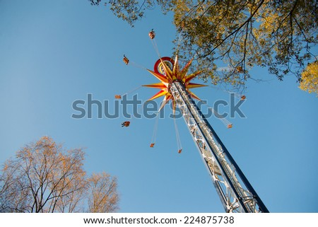 amusement park in autumn - stock photo