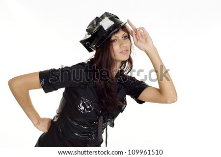 Amusing brunette in a suit of police on a white background - stock photo