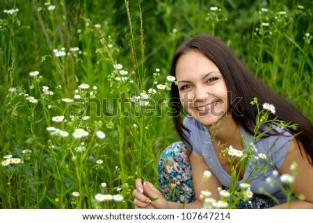 Amusing brunette with a sweet expression on her face in the countryside - stock photo