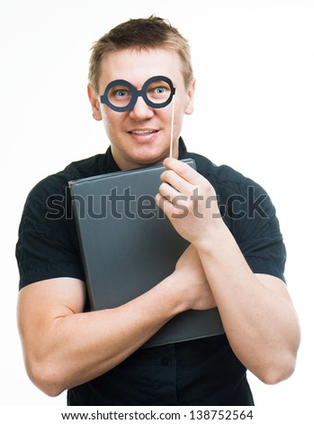 amusing man with fake glasses and book isolated on a white background - stock photo