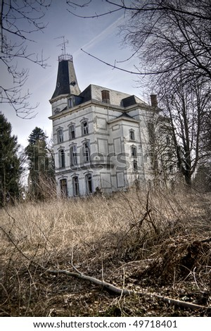 An abandoned Chateau, beauty gone lost. Nowadays it's a spooky place - stock photo