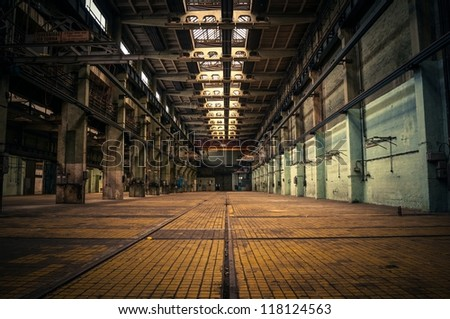 an abandoned industrial interior in dark colors - Industrial