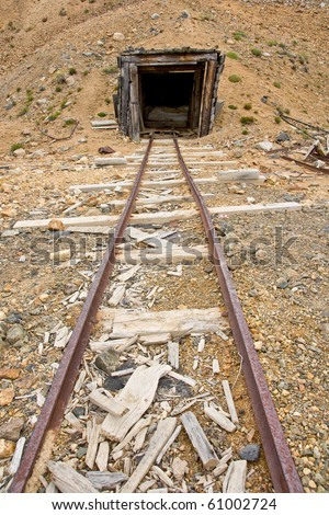 An abandoned mine shaft and rail - stock photo