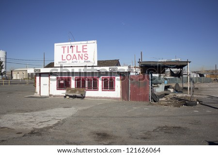 an abandoned title loan company building - stock photo