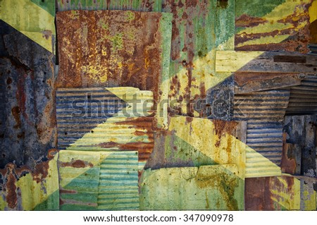 An abstract background image of the flag of Jamaica painted on to rusty corrugated iron sheets overlapping to form a wall or fence.