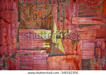 An abstract background image of the flag of Vietnam painted on to rusty corrugated iron sheets overlapping to form a wall or fence. - stock photo