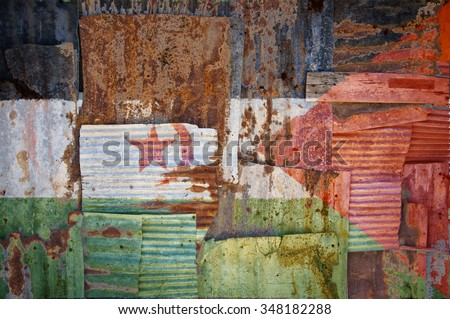 An abstract background image of the flag of Western Sahara painted on to rusty corrugated iron sheets overlapping to form a wall or fence. - stock photo