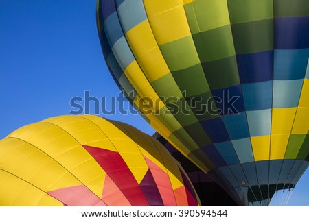 An abstract close up of two colorful hot air balloons - stock photo