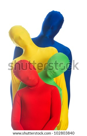 An abstract family of four wearing bright, colorful body suits.  Primary colors of red, blue, green and yellow. - stock photo